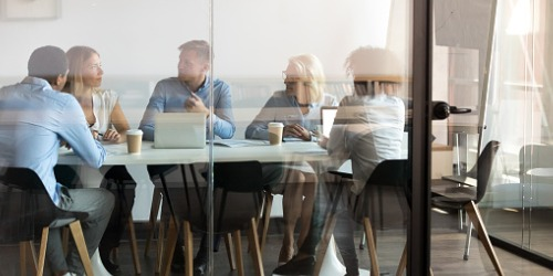 business-people-negotiating-at-boardroom-behind-closed-doors-picture-id1127397327